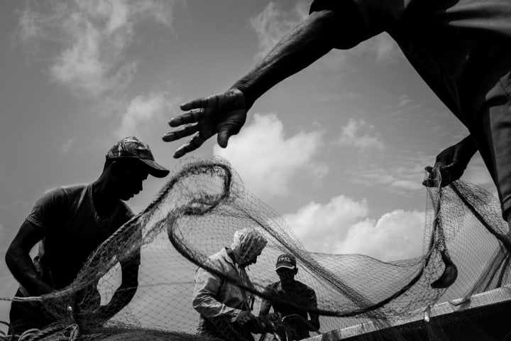 Fishmen prep their nets for the day - Pics Of Asia Phototours And Workshops
