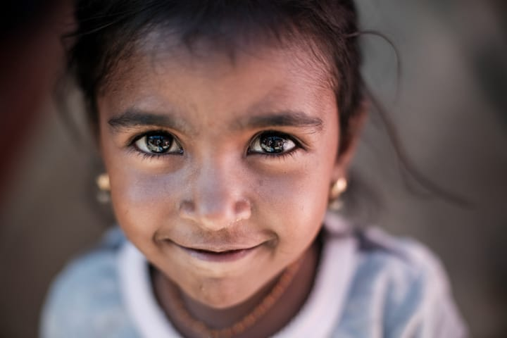 A Young Girl With Bright Expressive Eyes Looks Into the Camera - Pics Of Asia Phototours And Workshops