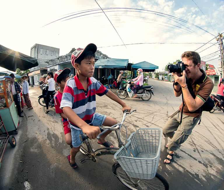 A Photographer Stops to Shoot A Portrait Of Two Young Men On A Bicycle In Vietnam - Pics Of Asia Photo Tours