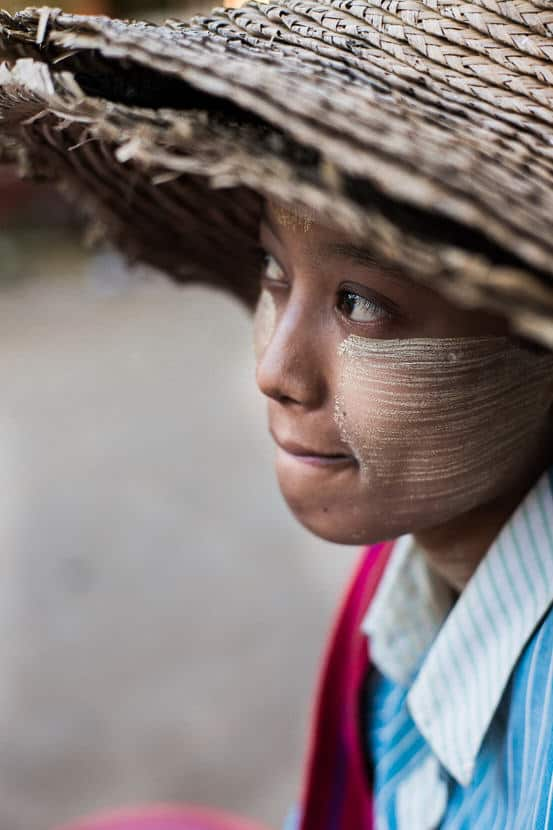 Close up portrait of a young Burmese woman in the streets of Nyaung Shwe during a Pics of Asia photography tour