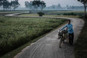 Man and bicycle in the fields around Bogra