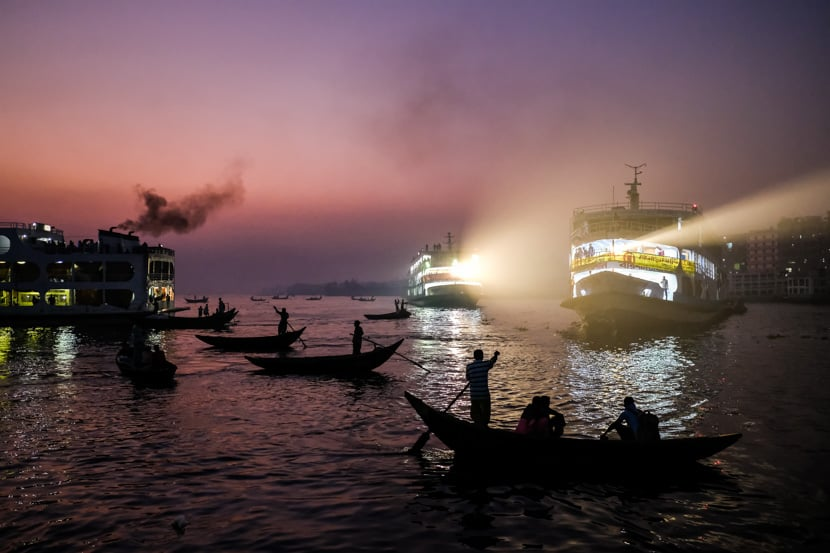 Boats Move Though A Harbor At Dusk In Bangladesh - On The Pics Of Asia Bangladesh Photography Tour