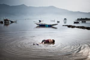 A Young Boy Takes A Break To Cool Off In Vietnam - Photo captured on Pics Of Asia's Vietnam Phototour