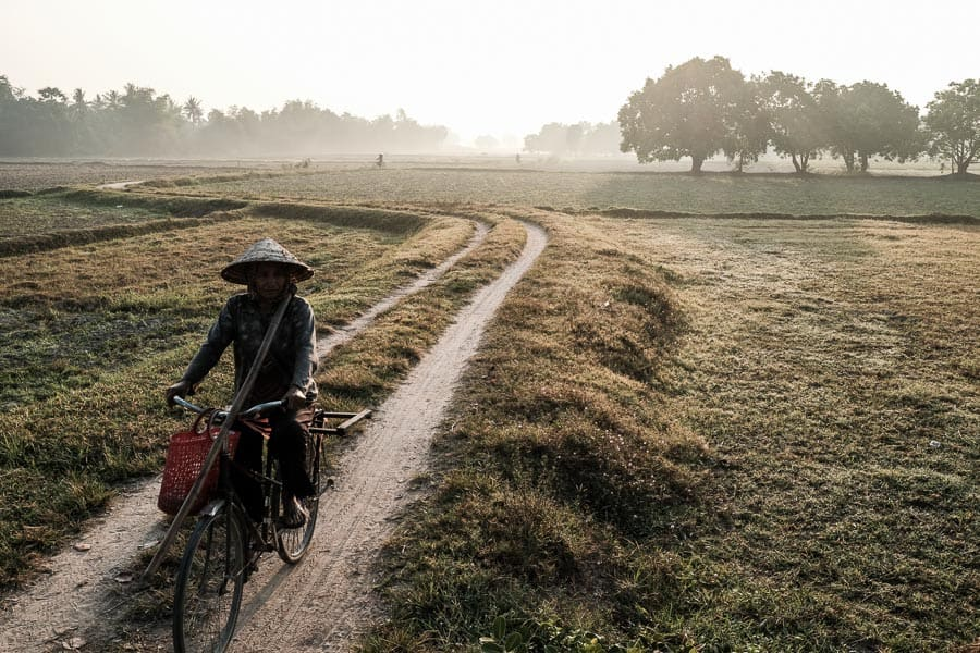 Khmer woman going to work in the fields in An Giang province