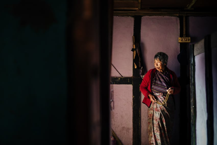 Old woman in her house in Bhutan