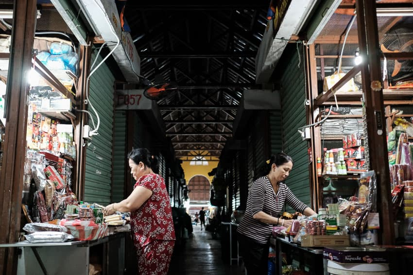 two women setting up their market stall in hoi an central market during Pics of Asia photography tour