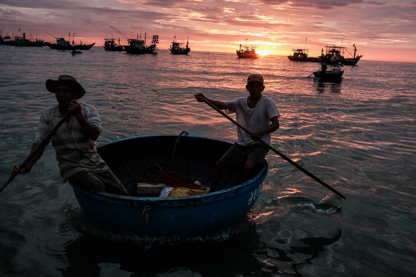 Capturing the fishermen on basket boats bring their catch from the sea at sunrise in central Vietnam during a photography tour with Pics of Asia