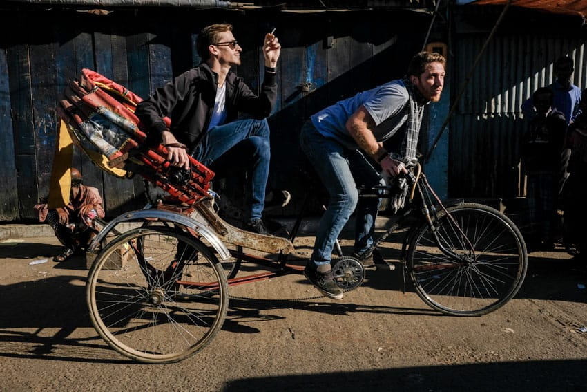 Photographers Etienne Bossot and Drew Hopper on a rickshaw while running a photography tour in Bangladesh for Pics of Asia