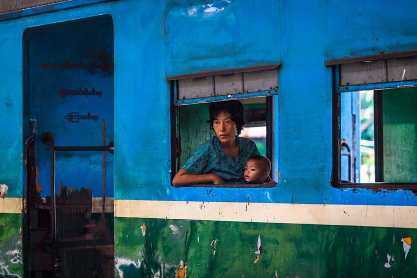 Creative photo of a mother and her child in Yangon train station. Photo by Quinn Ryan Mattingly for Pics of Asia
