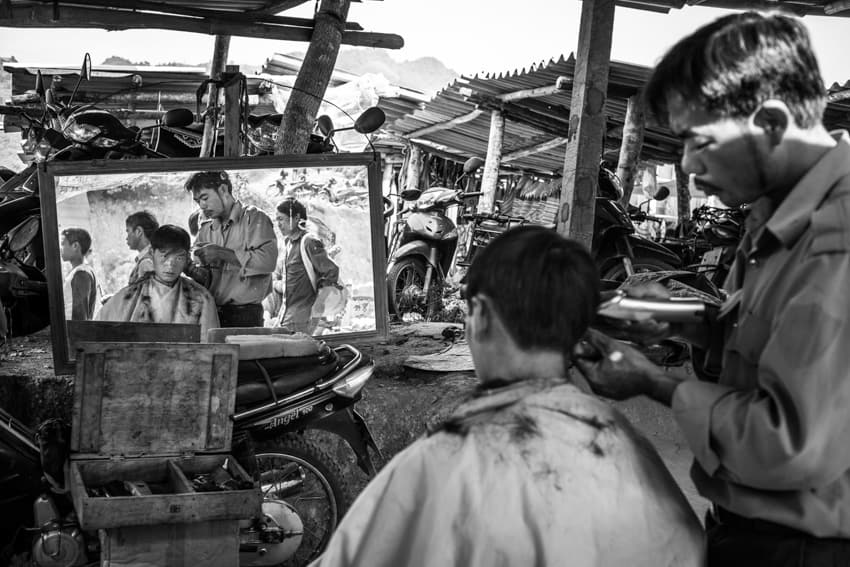 Local barber shop in Bac Ha, Vietnam. Photo by Quinn Ryan Mattingly for Pics of Asia
