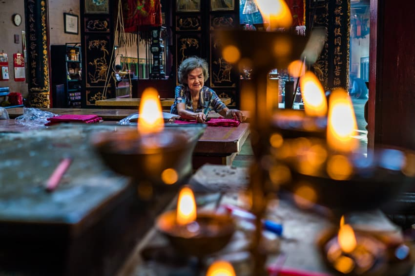 A Vietnamese woman guarding a temple in HCMC. Photo by Quinn Ryan Mattingly