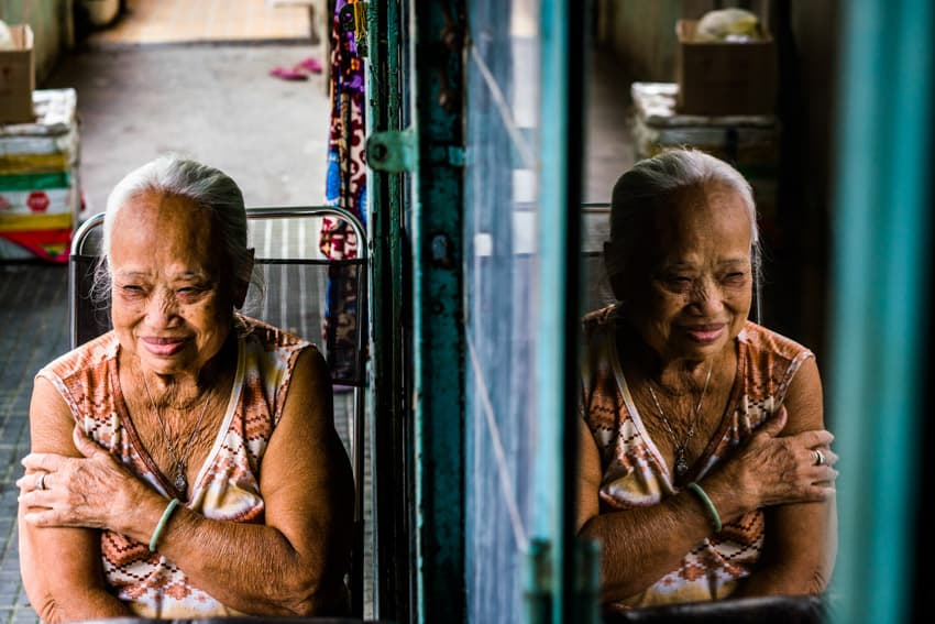 A creative portrait of an old Vietnamese woman. Photo by Quinn Ryan Mattingly
