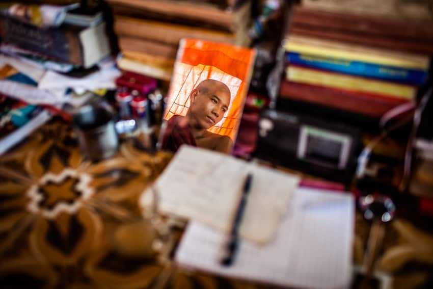 Using reflections for creative portraits, photo of a monk in Myanmar by Quinn Ryan Mattingly for Pics of Asia website