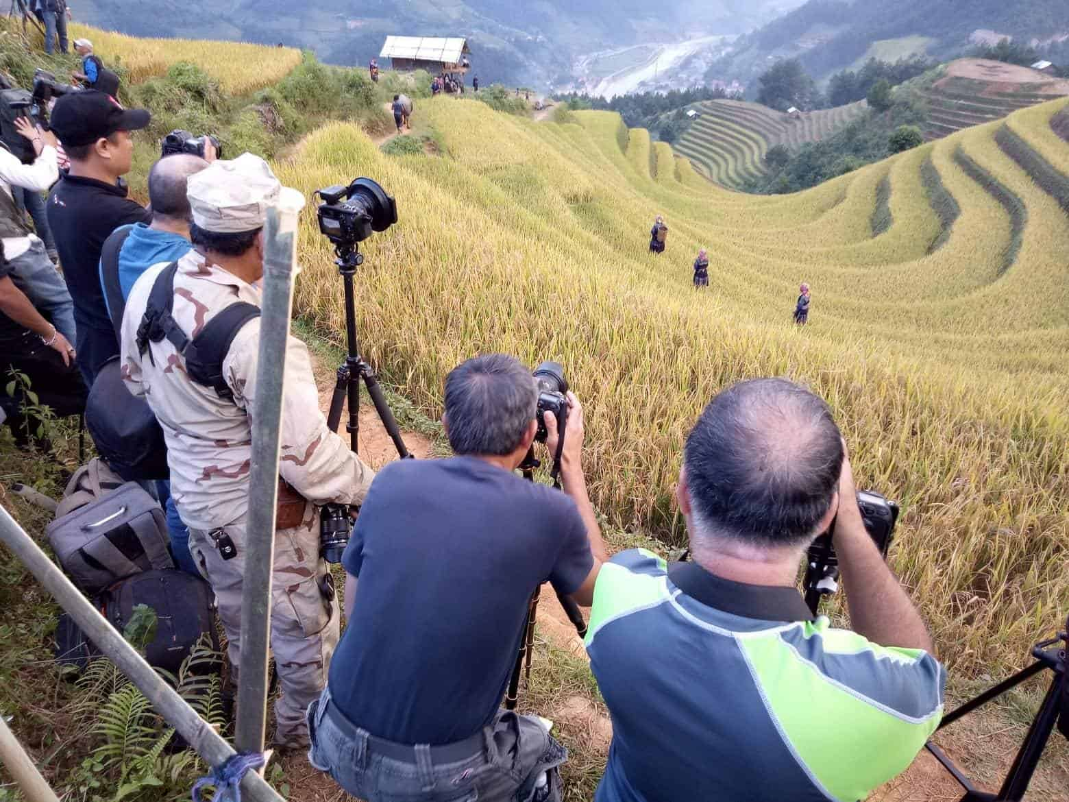Vietnamese photographers taking photos of models in the rice fields of Mu Cang Chai