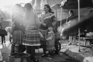 A group of Hmong women gathering in Bac Ha market in North Vietnam taken during Pics of Asia photography tour