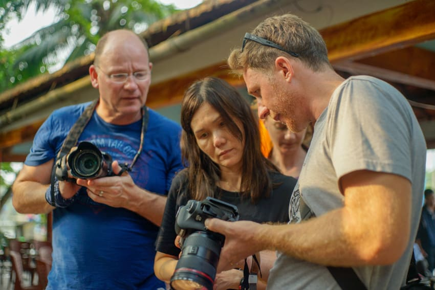 Teacher and students learning about travel photography in Vietnam