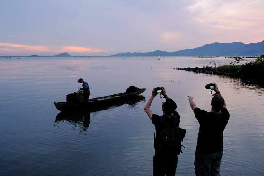 Student and teacher in Vietnam on a travel photography tour and workshop by Pics of Asia