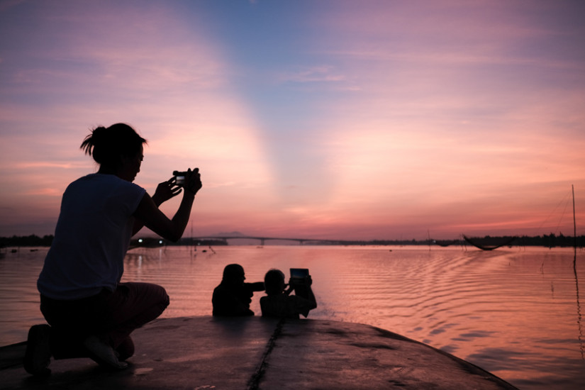 Taking photos of the fishing nets at sunrise on Hoi An river with Pics of Asia and hoi an photo tour