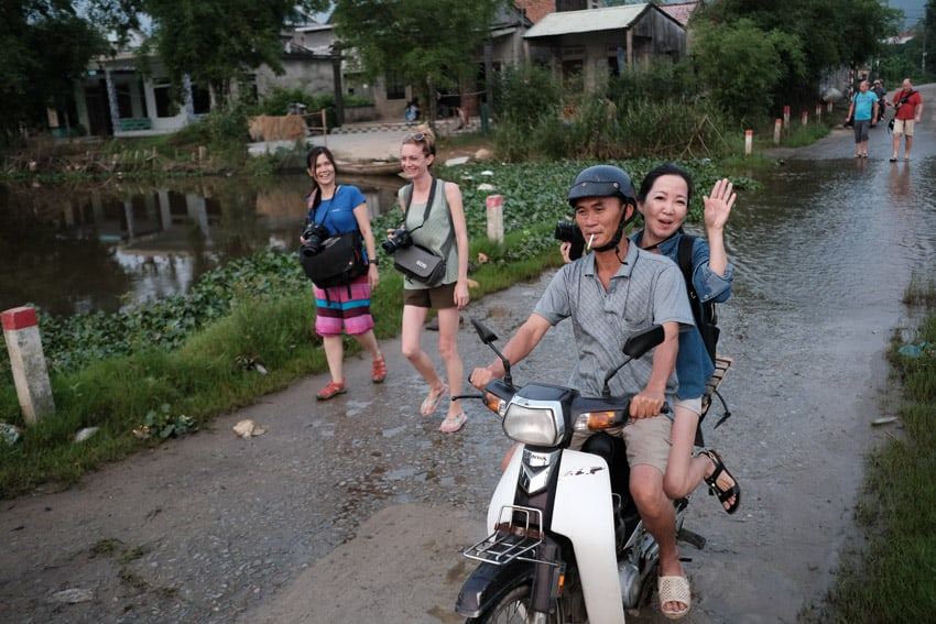 Photography tour students walking in the countryside of Hue with Pics of Asia
