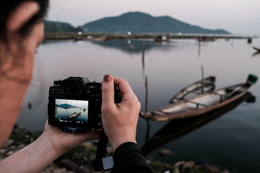 Student taking a landscape image in Hue with Pics of Asia photo tours