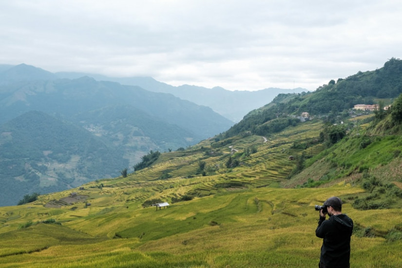 Photographer in the mountains of North Vietnam