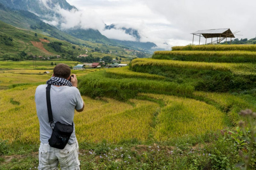 Photographer capturing the valley of Bac Ha on a photo tour with Pics of Asia