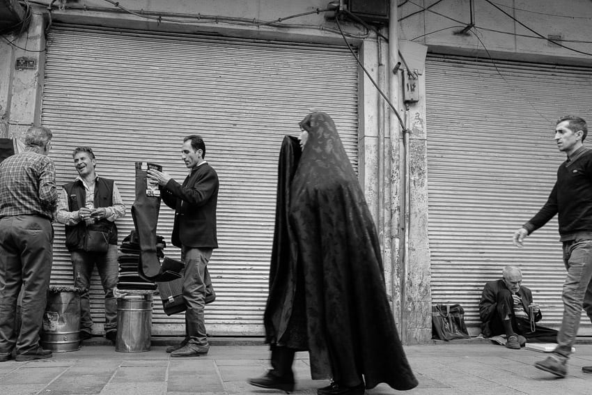 Locals going by in the bazaar of Kerman during Pics of Asia photography tour in Iran in 2018