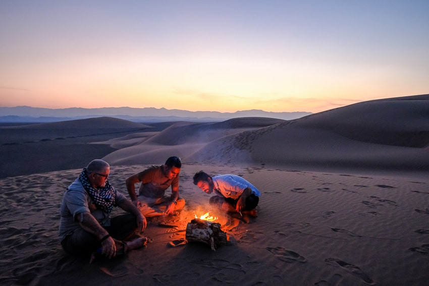 Pics of Asia photography group establishing camp on a sand dune in the desert of the Kalouts in South Iran