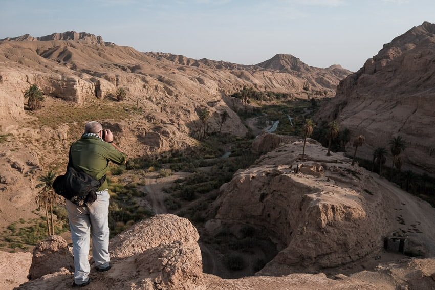 Taking photos of the canyon of Keshyt Oasis during Pics of Asia photography tour in Iran