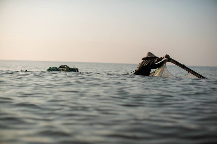 Early morning fishing on the coast of Nam Dinh, Vietnam, during a photography tour with Pics of Asia