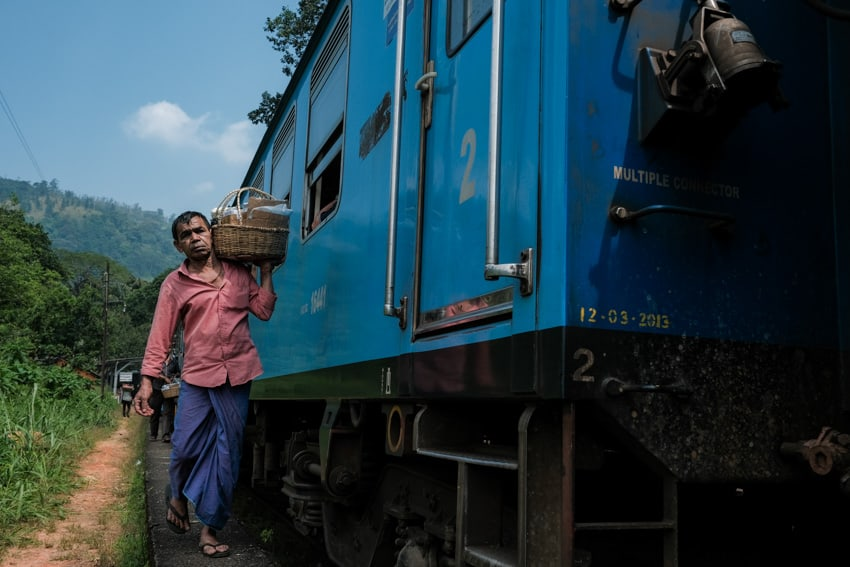 A man selling snacks to the train passengers on the way from Kandy to Nuwara Eliya