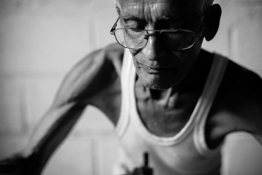 Portrait of a tailor taken in Galle wet market, Sri Lanka, during a photography workshop by Pics of Asia