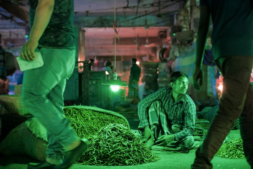 different coloured lights lit the vegetable sellers in Kerwan Bazaar, Dhaka
