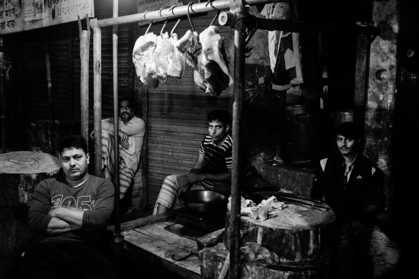 Night photograph of meat sellers in the night market of Rajshahi, Bangladesh