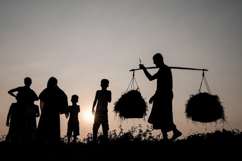 Farmers getting ready to head back home after working in the fields near Dinajpur, Bangladesh