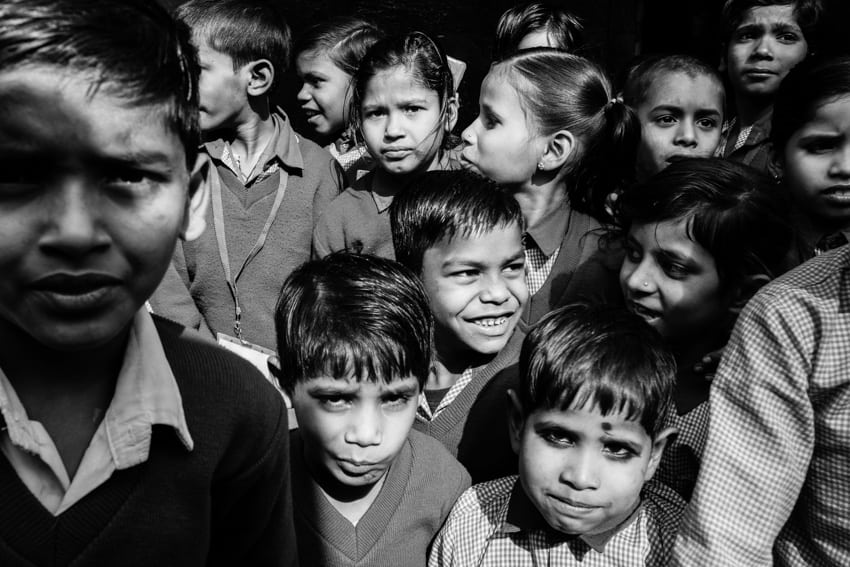A group of school children in the countryside of Varanasi posing for a picture during a photography tour with Pics of Asia