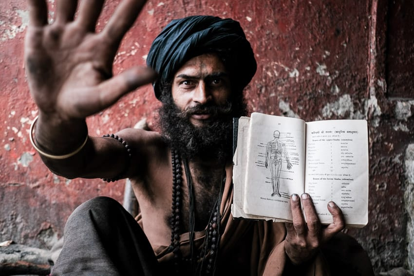 A Sadu in Kolkata, India, showing his study book about the human body during a photography workshop with Pics of Asia