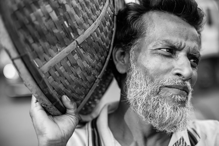 Portrait of a man carrying vegetables in Sylhet market