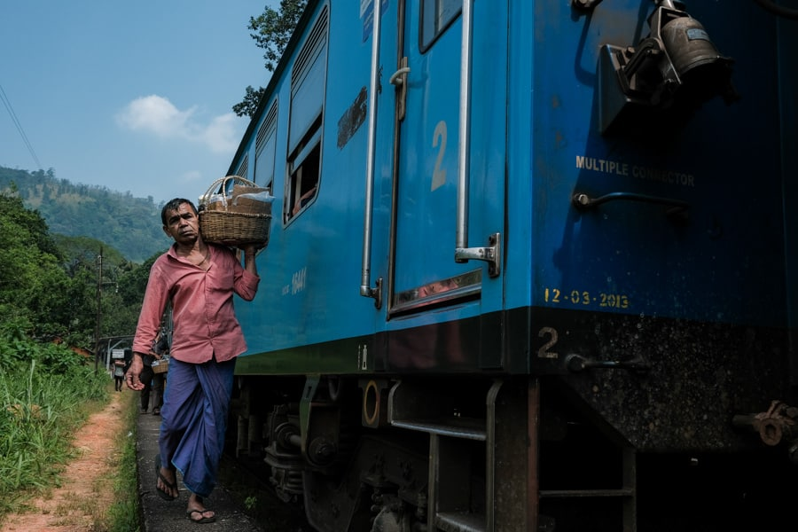 locals enter the train to sell food during the train ride in Sri Lanka