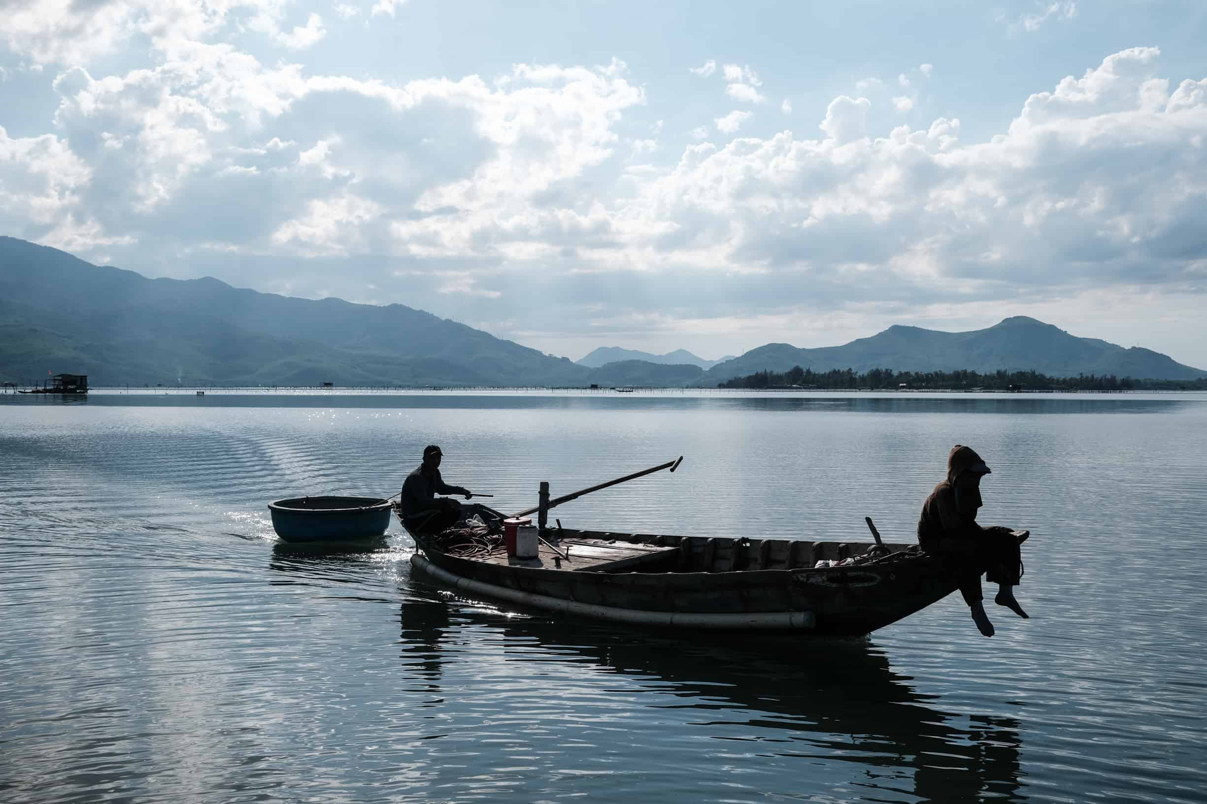 Two fishermen come back home from fishing in Lang Co lagoon in Vietnam
