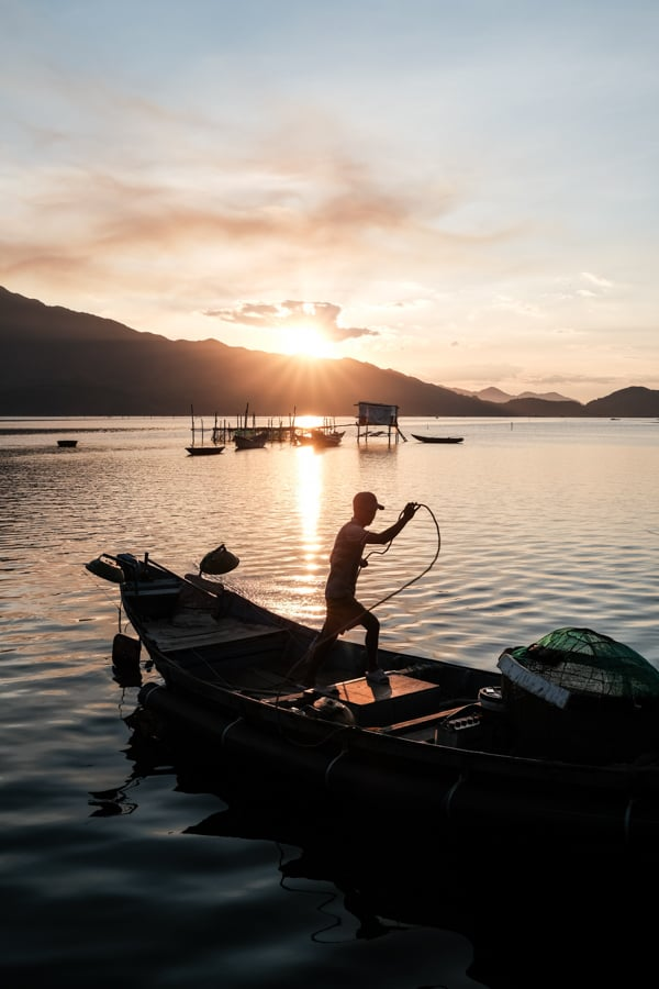 A fisherman prepares to go at sea on Lang Co lagoon in vietnam