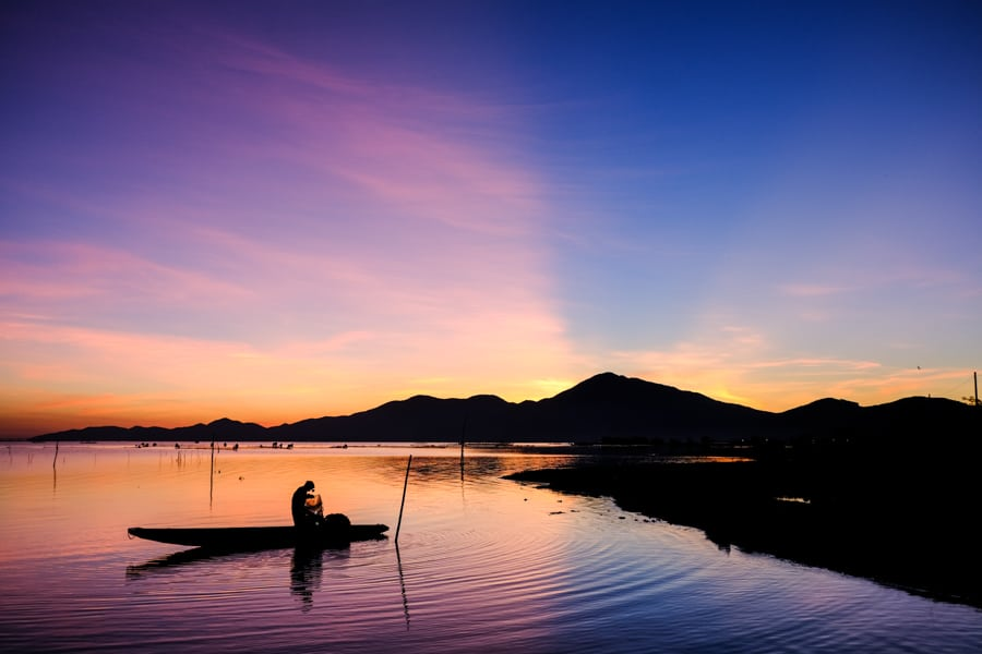 Fisherman at sunrise on a lagoon around Hue on a photography tour with Pics of Asia