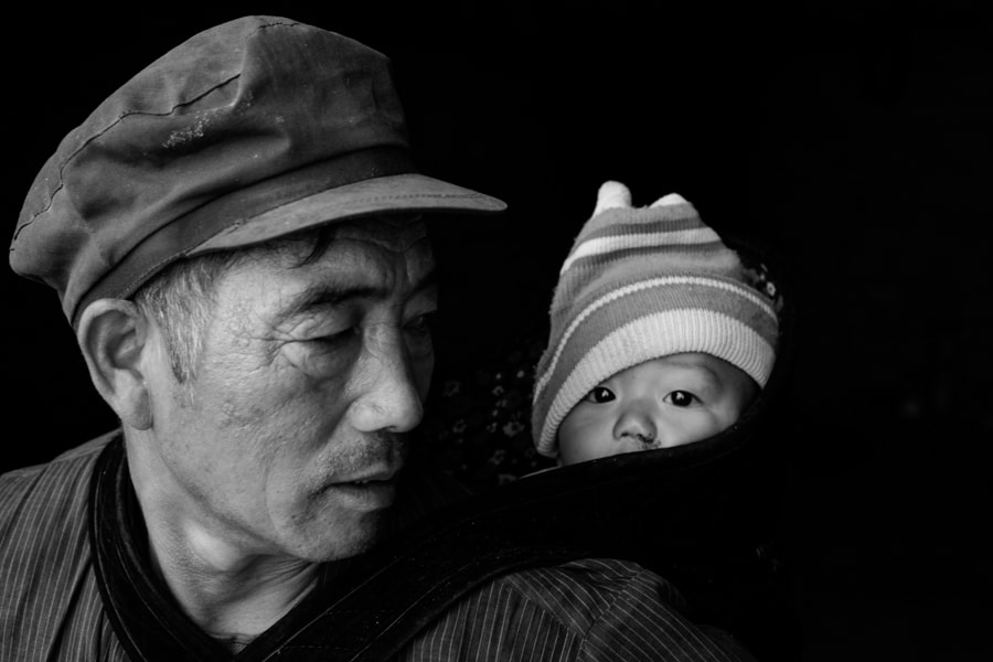 Portrait of a Ha Nhi man and his grand child in Y Ty, Vietnam