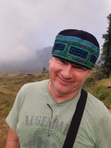 wearing a Hmong hat and having fun on a photo tour with Pics of Asia