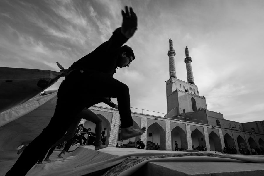 folding the tents after Arba'een festival in Jameh mosque in Yazd, Iran