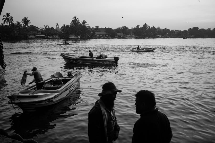 Fishermen at surnsie in the fish market of Negombo on a photography tour in Sri Lanka with Pics of Asia