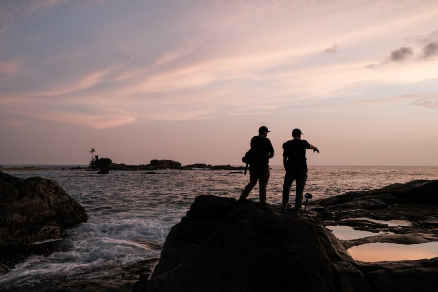 Two photographers capturing the sunset in Sri Lanka on a photography tour with Pics of Asia