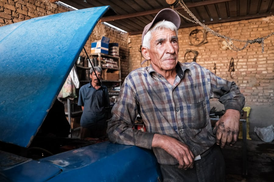 a mechanic in his workshop in a village in Iran