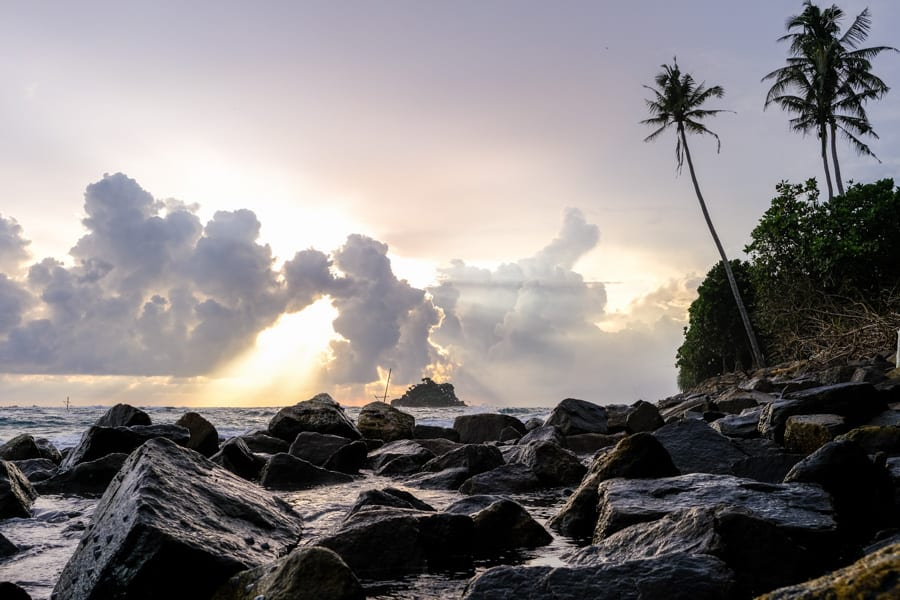 Taking photo of the sunset with rocks and palm trees in Sri Lanka with Pics of Asia photography tours and workshops
