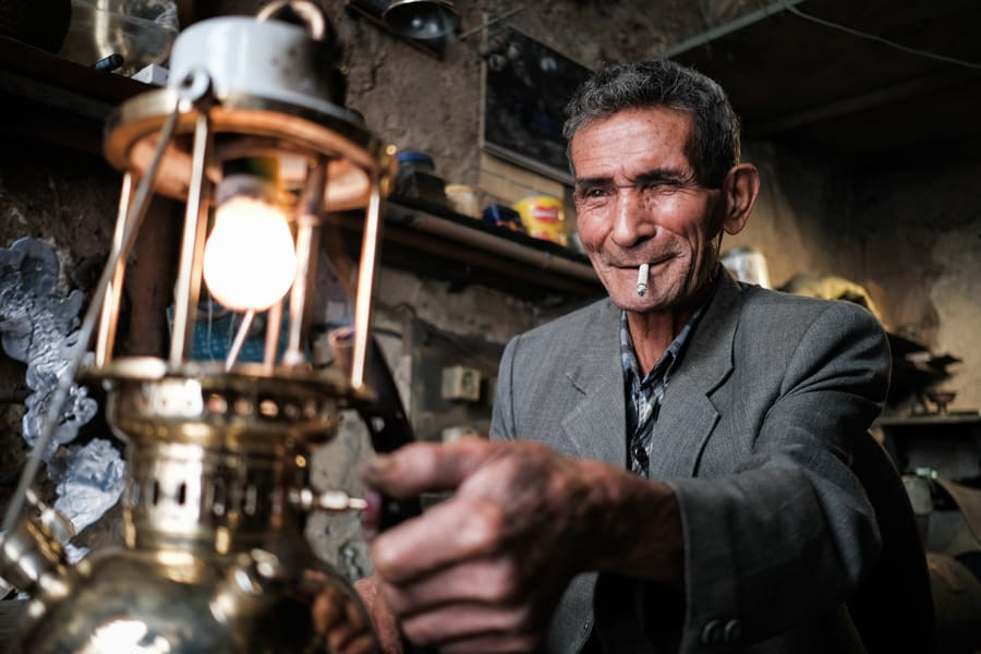 The old man fixing the old lamps in the bazaar of Neyshabur